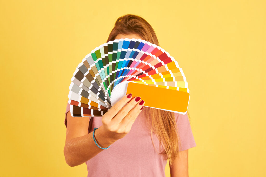 interior-designer-woman-holding-a-color-guide-palette-isolated.jpg